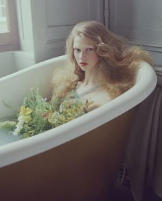 Beautiful who would have thought to put flowers in the bath tub?!!! So cool of a photo or in real life at tub time ! :)