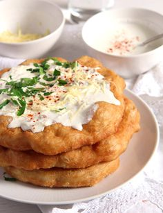 Crispy Hungarian fried bread Langos - topped with garlic sour cream and grated cheese or simply sprinkled with sugar. Hungarian Cuisine, European Cuisine, Hungarian Recipes, Hungarian Food, Hungarian Bread Recipe, Hungarian Cake, Romanian Recipes, Austrian Bread Recipe, Hungarian Desserts