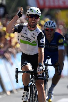 #TDF2016 Mark Cavendish celebrates as he crosses the finish line ahead of Germany's Marcel Kittel at the end of the 2085 km fourteenth stage...