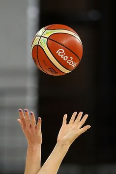#RIO2016 China and Serbia reach for the ball during tip off to the women's basketball game on Day 7 of the Rio 2016 Olympic Games at the Youth Arena on August...