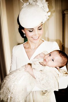 Catherine, Duchess of Cambridge and her daughter Princess Charlotte of Cambridge pose for a photo in the Drawing Room at Sandringham House after the christening of Princess Charlotte of Cambridge on the Sandringham Estate on July 5, 2015 in King's Lynn, England.
