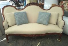 Beautiful carved wood antique loveseat.