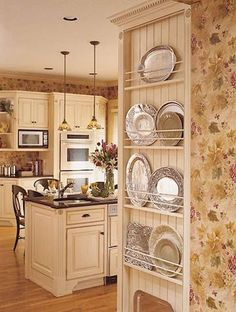 Small Kitchen Ideas: Traditional Kitchen Designs An Open Plate Rack is a great idea for the side of a refrigerator that might oherwise go un-used. A nice spot for those in-frequently used but pretty platters Kitchen Pantry, Diy Kitchen, Kitchen Storage, Kitchen Dining, Kitchen Ideas, Wall Storage, Storage Ideas, Dish Storage, Kitchen Cabinets