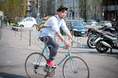hipster young man on bike from $1