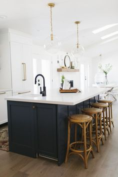 Gorgeous Kitchen .... dark island ... white perimeter ... gold accents .... We are excited to reveal our latest design today! The Centerville project was so much fun to work on. We feel so lucky when our clients have great taste and make our job easy. Our main challenge in the Living Room was to fill the long white wall. We did so by sourcing a large …