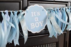 Its A Boy Baby Shower Garland Party Decoration Ribbon Garland A sweet baby blue mix ribbon garland made with coordinating Its a Boy die cuts in baby blue colors. Available in 4, 6 and 8 lengths. There is one Its a Boy die cut for every 2 of ribbon garland. These ribbon garlands have an additional 2 of jute string on either side for tying. Please contact us for a quote for custom lengths of garland. These garlands are perfect for a variety of uses... - Photo prop backdrop - Nursery decor…