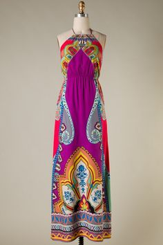 Fun print on this gorgeous halter style maxi dress. Neck tie with an elastic band at the waistline. Made of 100% rayon. Fits true to size: Small 2/4, Medium 4/6, Large 8/10