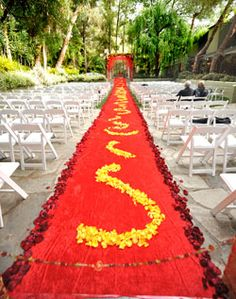 Red floral ceremony aisle  luscious bridal red & yellow petals...eco-friendly  www.flyboynaturals.com