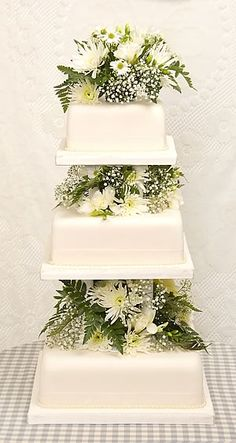 3-tier wedding cake with pillars and flowers