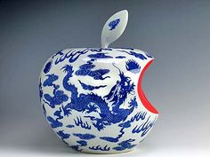 A photo of a piece of blue and white Chinese pottery in the shape of an apple