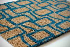 DIY doormat.  Contact paper + spray paint.  Genius.
