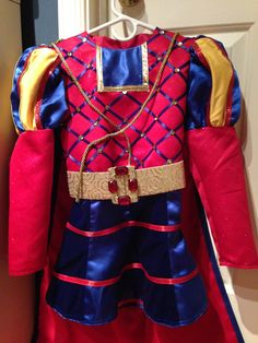 Farquaad. Lots of nit-picky detail work with this one. I attached the ribbon by hand to create the diamonds and then glued sequins into the points. I cut a gore pattern for the skirt and alternated blue sparkling satin with blue stretch velvet. After an incredibly frustrating hour or two trying to baste velvet to satin and then sew it, I went out and bought a basting glue stick. Wow, I wish I had known about these sooner. Shrek Costume, Costumes, Lord Farquaad Costume, Going Out, Musicals, Diamonds, Sequins, Ribbon, Sew