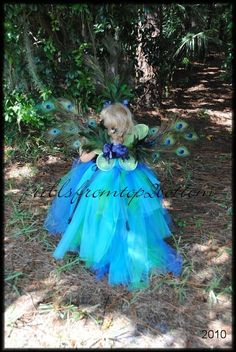 Infant/Toddler Peacock Tutu Dress and Feather Headband ... Unique Costume or Party Attire... SIZES up to 3T. $65.00, via Etsy.