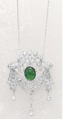 A Diamond and Emerald Brooch, 1890
