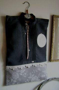 Laundry Bag shirt on hanger, BLACK hemp canvas to mattress to gray flowers  a shirt old in flax dyed black associated with a backdrop to mattress to gray flowers, embroidery scalloped white hand, badge MD applied in medallion surrounded by white croquet, ribbon to initials and number 287 on the border of the plastron, button of pearlm English Seams interior non-double - Opening of the bag at the level of the decorative buttons - book with its wooden hanger adorned with a small metal plate 3