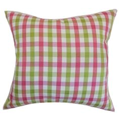 Toss this fabulous and chic throw pillow on your sofa, bed or chair for a style makeover. This accent pillow features a plaid pattern in flamingo pink, green and white hues. This square pillow provides a funky and vibrant twist to your interiors. Match this pillow with stripes, geometric or zigzags for a modern vibe. Made from 100% soft and high-quality cotton fabric. $55.00  #plaid #tosspillow #homedecor