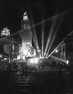 """The caption for this photo of the Carthay Circle Theater said it was taken at the Invitational preview of """"The Song of Bernadette"""" in 1943. I'm a bit surprised that they'll pull out all the stops—and searchlights—for a preview, but, well, you know Hollywood: any excuse to beat the ballyhoo drum. I suspect this is actually the premiere, but either way, it makes for a great photo, don't you think?"""