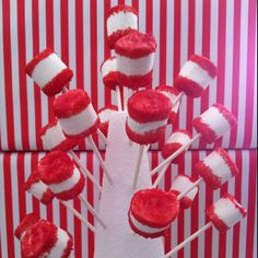 Cat in the Hat party for kids. These are made with marshmallows and red sugar sprinkles.