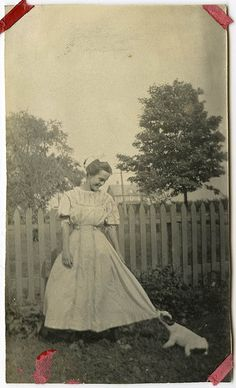 """vintage photo, girl with funny puppy tugging at her hem .... """"let's play!!"""""""