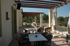 Within a beautiful landscape of olive groves, this traditional guest house offers beautifully appointed accommodation with its own farm and animals, a. Lodges, Beautiful Landscapes, Terrace, Greece, Pergola, Outdoor Structures, Traditional, House, Island