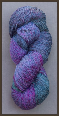 Iris: Cotton Rayon Twist/Lace This is a very soft yarn and the two fibers are twisted together, not blended. This gives the yarn a matte/ shiny look and the the fibers take the dye differently giving a broader range of color.