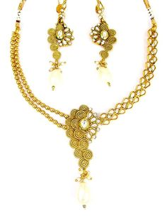 Stunning gold plated brass metal necklace studded with pearls, kundan and golden beads. Item Code: JPD86909 http://www.bharatplaza.com/new-arrivals/jewellery.html