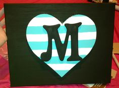 DIY. Paint a canvas. Add a wooden heart with hot glue and add a letter for personal monograms! #dorm #canvas #diy