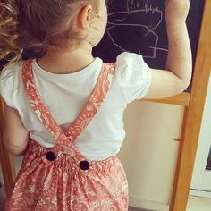 """@cottontail.nz - """"Managed to snap a quick photo while Olive was drawing a masterpiece. Love the back of the pinafore dress!"""""""