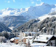 Family skiing in Madesimo, Italy