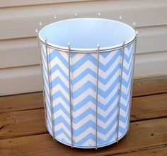 spray paint trashcan..you can also cut a hole in the bottom and hang it from a light in your bedroom