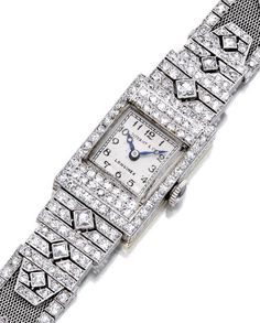 An art deco diamond and platinum wristwatch, Longines, Tiffany & Co. circa 1925 the rectangular white dial with Arabic numerals and blued-steel hands, 18 jewels, within a pavé-set diamond bezel, joined by pavé and French-cut diamond shoulders, completed by a mesh bracelet accentuated with circular and single-cut diamonds; dial signed Tiffany & Co.; estimated total diamond weight: 3.50 carats; mounted in platinum and eighteen karat gold.