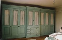 hand made and painted fitted wardrobes