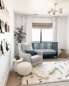 modern nursery with black crib and gold modern chandelier modern boho nursery, gender neutral nursery baby nursery decor, nursery design ideas with modern crib, kid room decor ideas with glider and wallpaper and book ledge Baby Bedroom, Baby Boy Rooms, Baby Room Decor, Baby Boy Nurseries, Baby Room Ideas For Boys, Babies Nursery, Bedroom Kids, Neutral Baby Rooms, Gender Neutral Nurseries