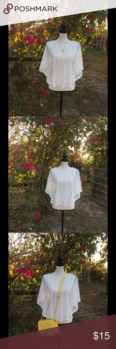 """Lavish White Crochet Poncho This poncho is absolutely lovely! No matter how you style it, I can guarantee it will look positively stunning. Brand is Lavish.  Measurements: Length: 22""""  10% of the proceeds of this item go to HOWMS.ORG, a charity devoted to building homes for orphans, widows, and the elderly in Malawi, Africa. (To read more please check out my """"News Update"""" Listing) Lavish Tops Blouses"""