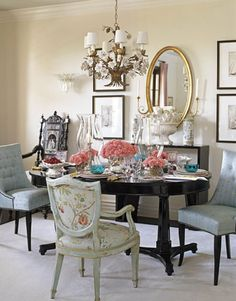 Love the color palette, wall art, mix of chairs