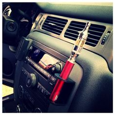Ecig, E Cigarete Car Holder by Accent Fixtures, http://www.amazon.com/dp/B00E53MXD0/ref=cm_sw_r_pi_dp_9NPcsb1P6KD5B