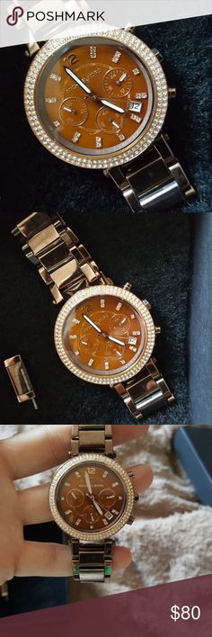 Beautiful Michael Kors watch Good condition has a knick on the face some scratching very minimal Michael Kors Jewelry