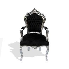 Solid Beech wood French Louis XV baroque style arm chairs; 1- Painted and finished in black color. 2- Silvered with French silver foils.Carved ornamented with beautiful handmade carvings represent foliate designs and shells, and upholstered with black velvet fabric