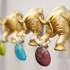 Using toy elephants and gold spray paint, create these cute little magnets for your fridge!