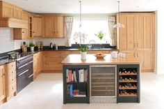 Rencraft Oak Kitchen - http://rencraft.co.uk/kitchens/oak/case_study/bespoke_oak_kitchen_painted_island_with_complementary_wooden_worksurface_kent