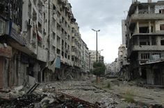 Debris litter a deserted street in the Christian neighborhood of Hamidieh in Homs, Syria on May 8.