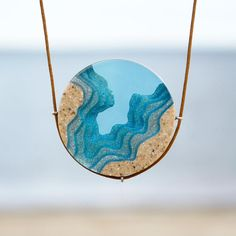 The Abyss – Beach necklace with round pendant handmade from sand and aqua blue resin on cord - Diy Jewelry Easy Beach Jewelry, Diy Jewelry, Jewelry Accessories, Handmade Jewelry, Jewelry Stores, Gems Jewelry, Jewelry Ideas, Jewelry Bracelets, Fashion Jewelry