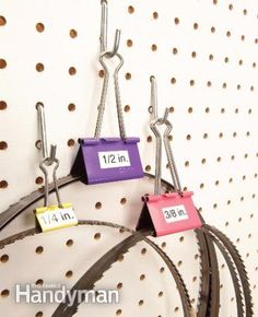 Nest blades inside binder clips/ Nest the coiled blades into binder clips and store them on your pegboard, and they'll never spring out at you again. Apply labels to the clip so you can simplify size selection and storage.  Read more: http://www.familyhandyman.com/tools/storage/clever-tool-storage-ideas/view-all#ixzz3E7KaufIm