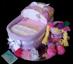 "Custom Bassinet Baby Gift (Girl) Shalea Design by ""Shalea Gifts"" Contains –  35 Infant Nappies 1 x Pink Scalloped Baby Blanket 1 x Baby Singlet 000 1 x Summer Onsie 000 1 x Burp Cloth 2 x Baby Feeding Bibs 1 x Baby Wash Cloth 1 x BNF Plush Toy 1 Silver Cake Tray  Decorated, Embellished, Finished with Cellophane & Ribbon"