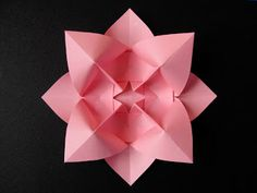 Origami: Fiore bombato, variante - Curved flower, variant. Designed and folded by Francesco Guarnieri, March 2009.