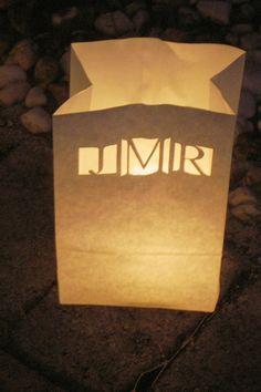 50 Personalized Wedding Candle Luminaries (White) with Custom Laser Cut Monogram. $56.95, via Etsy.