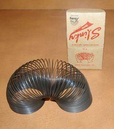 Vintage Slinky Toy 1960s.    I was given one for christmas even though we lived in a bungalow, lol
