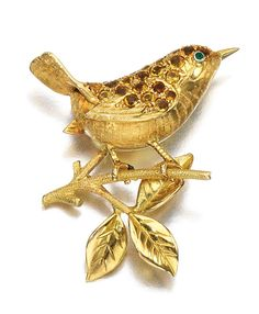 GEM SET BROOCH designed as a wren, set with circular-cut citrines and a cabochon emerald eye.