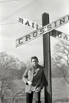 "Johnny Cash in 1968, near the Arkansas farm where he grew up. From photos by Joel Baldwin for the Look magazine assignment ""The Restless Ballad of Johnny Cash."""
