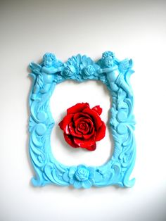 aqua and red. rose and frame